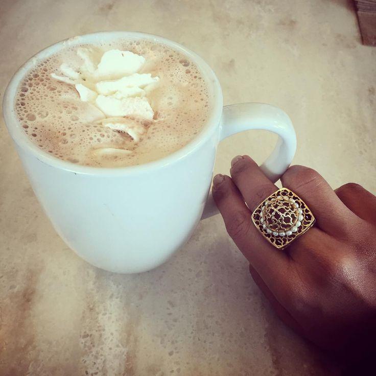 Fashionista Priyanka Khanna enjoys a cup of hot chocolate at Ghirardelli Square wearing ISHARYA Royal Filigree statement ring.