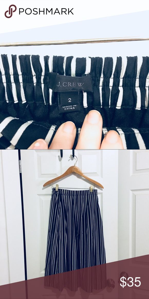 J. Crew navy striped skirt Beautiful, navy and cream striped skirt purchased new from J. Crew. Size 2. Elastic paper bag waist. Falls mid-calf like a dream. 100% polyester and fully lined. Asking $30 or best offer. J. Crew Skirts Maxi