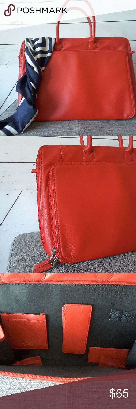 "Like New Red Levenger Briefcase Bag Buttery soft and bright red this is a great soft briefcase that will carry a thin 15"" laptop and all of your other essentials. Only carried it to interviews and yes, I did get every job! This is a classic case with simple, elegant lines - nothing fussy and a great pop of color. It is missing the long shoulder strap but you may be able to find one on the web. Levenger Bags Laptop Bags"