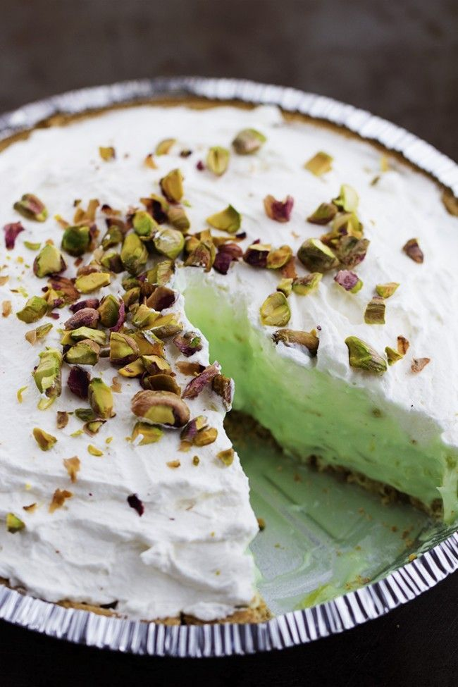 •1 package (8 ounces) cream cheese, softened •1 cup milk •1 package (3.4 ounces) instant pistachio pudding mix •1 can (8 ounces) crushed pineapple, drained •1 (9 inch) graham cracker crust •2 cups heavy whipping cream •3 Tablespoons powdered sugar •coarsly chopped pistachios for garnish