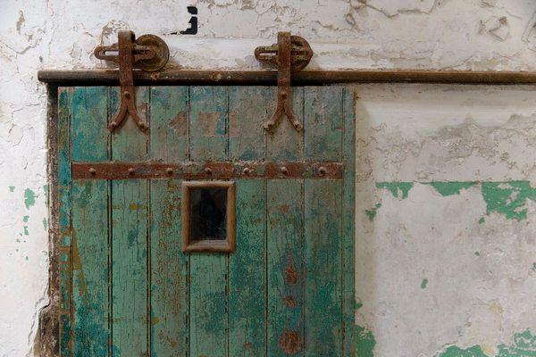 Sale eastern state - sliding wood door - old doors - cell door - prison decor - door photography - philadelphia doors - city of philadelphia by OnYourWallGallery on Etsy https://www.etsy.com/listing/400272745/sale-eastern-state-sliding-wood-door-old