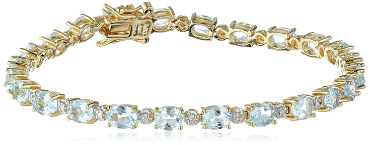 """18k Yellow Gold-Plated Sterling Silver Two-Tone Sky Blue Topaz Tennis Bracelet, 7.25"""". Gold-plated tennis bracelet featuring prong-set gemstone ovals patterned with small round-cut diamonds. The natural properties and composition of mined gemstones define the unique beauty of each piece. The image may show slight differences to the actual stone in color and texture. All our diamond suppliers confirm that they comply with the Kimberley Process to ensure that their diamonds are conflict-free."""