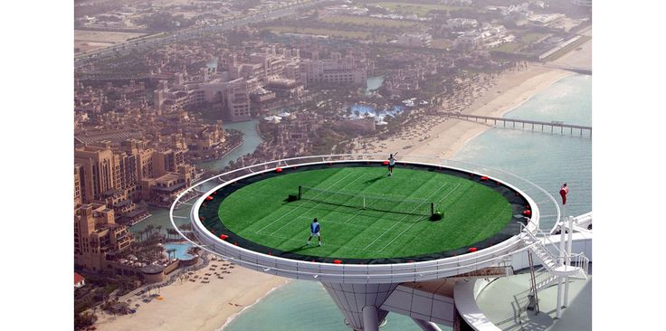 Tennis atop Burj Al Arab, Dubai  I would hate to be the ball boy for that!