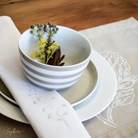 Napkin with Watsonia design on a Stone Place Mat with Sugar Bush Design.