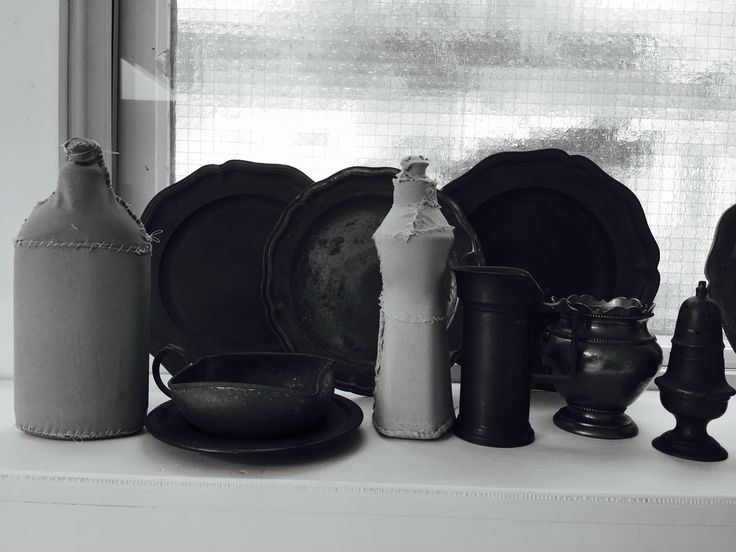 Baetenmaes art, still life with textile covered used plastic bottles.