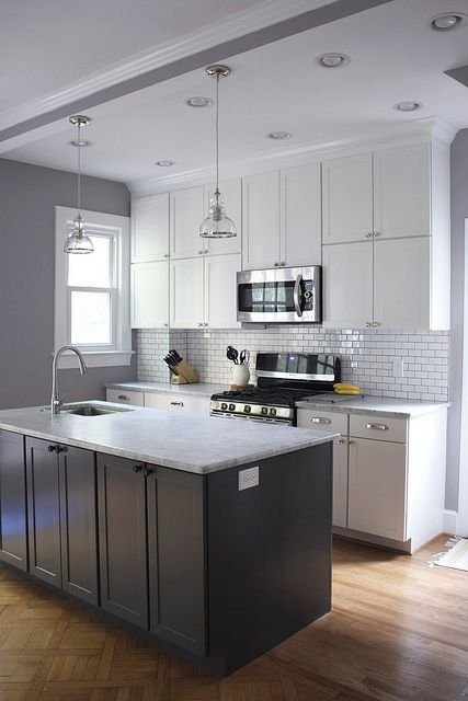 Gorgeous kitchen remodel. Gray and white cabinets, huge island, white subway tile with pewter/gray grout