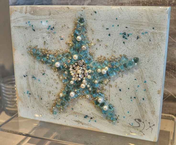 "Who couldn't use some sparkle? This art piece is sure to please the eye and doesn't disappoint.  ""Starfish"" by Sharon Kator is a favorite among our customers. 8 x 10."
