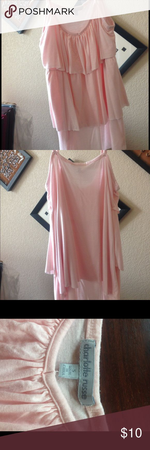 Size S Charlotte Rouse Ruffled Tank Cute pastel pink ruffled tank, perfect for making an office outfit cute or for a light summer outfit. Charlotte Russe Tops Tank Tops