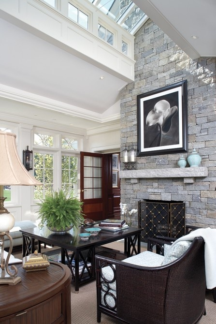 the beautiful stone fireplace takes your eye up to the skylights. . . . .