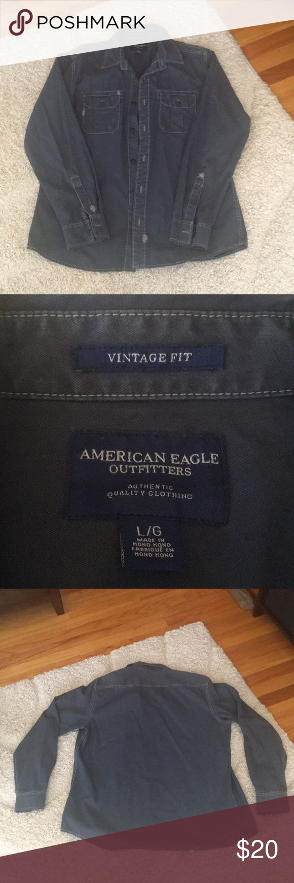 American Eagle Men's Button Up American Eagle Men's Button Up, Vintage Fit, there are a couple of worn areas on the pockets but I think it was made like that. It just looks distressed. American Eagle Outfitters Shirts Casual Button Down Shirts