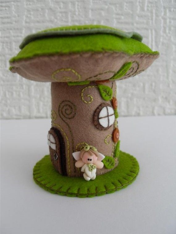 "Pretty little fairy house pincushion, complete with the cutest little fairy* standing outside her front door.    Height : 3.75""  Widest part"