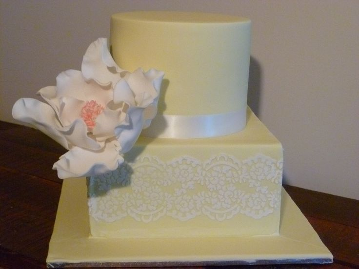 2 tier chocolate mud cake with hand made sugar flower and stencil detail.  Available in colour and flavour of choice.