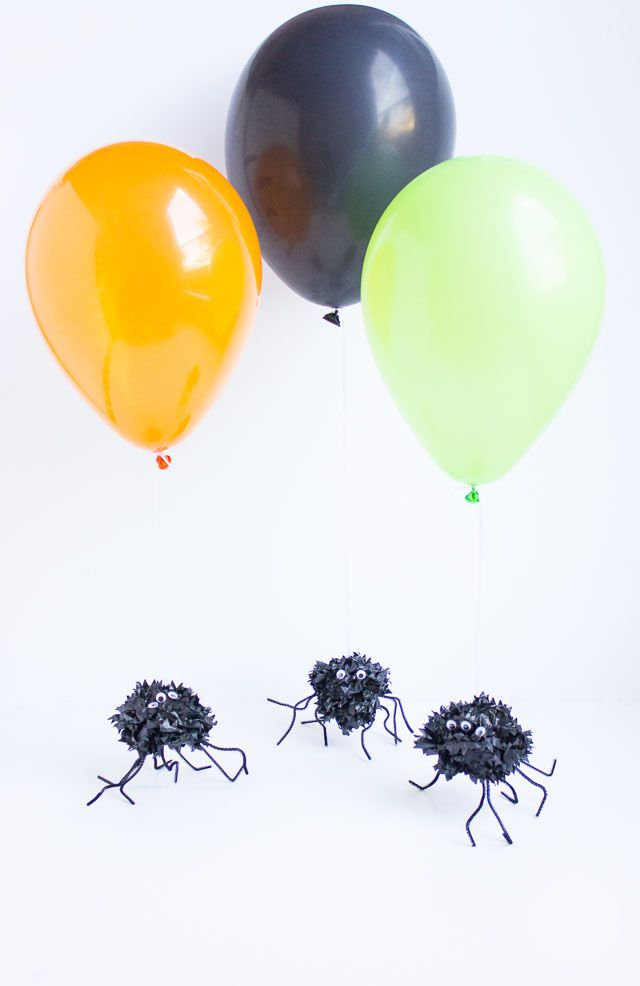 add these pom pom spiders to the end of a helium balloon for a fun halloween alternative to a traditional balloon weight - Halloween Pom Poms