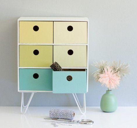 Transform IKEA's moppe mini chest drawers by painting it your favorite colors and adding legs. It looks great on your desk or shelf.:
