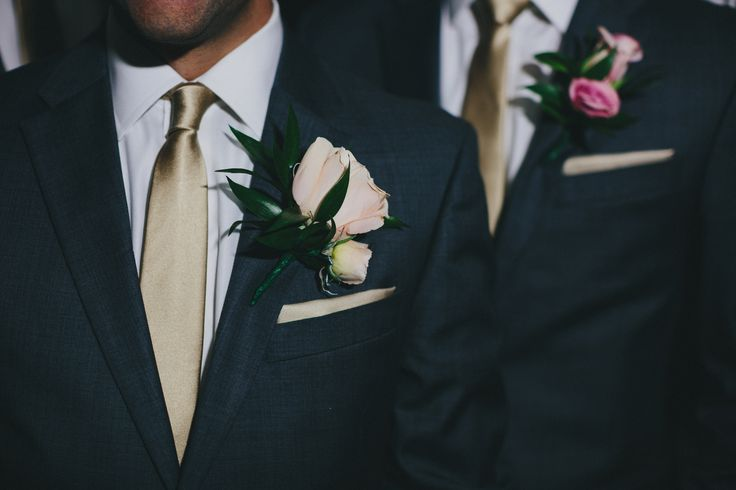 Groomsmen charcoal grey suits, champagne tie and pocket square, white shirt