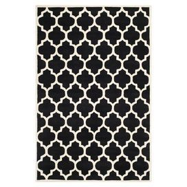 Hand-tufted wool rug in black with a quatrefoil motif. Made in India.  Product: RugConstruction Material: 100% WoolColor: Black and ivoryFeatures:  Made in IndiaHand-tufted Note: Please be aware that actual colors may vary from those shown on your screen. Accent rugs may also not show the entire pattern that the corresponding area rugs have.Cleaning and Care: Professional cleaning recommended