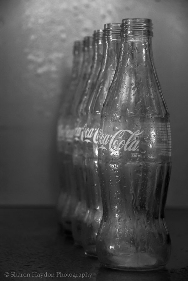 L2M2AP3 (2) Rhythm. M mode. I lined up the coke bottles to create a sense of rhythm. Tripod and reflector used. Shutter speed 1/3 sec at f/6.3, ISO 800