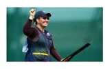 """IMG211d: A positive image of an American female shooter, Kim Rhodes, displaying a sort of victory. This image is under the """"Must See"""" sections which suggests that ESPN might be drawing attention to a less known sport in the US."""