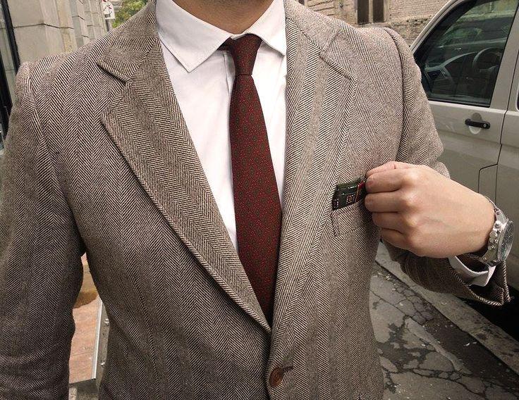Cristian strikes again! Wearing a nice herringbone jacket + silk tie + T.C. pockesquare!