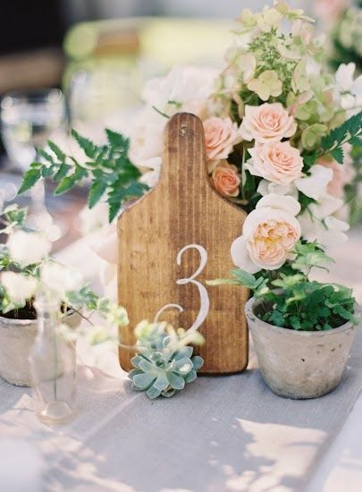 elegant table number idea wooden table numbers with succulents and peach roses courtesy of