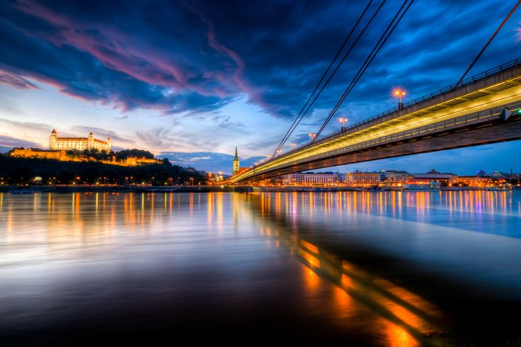 Bratislava Castle rising above the Danube River and the New Bridge (HDR by theodevil)