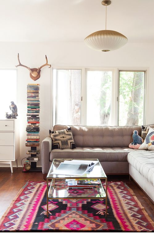 Love this look. Modern furniture with southwestern accessories makes the room feel cozy!