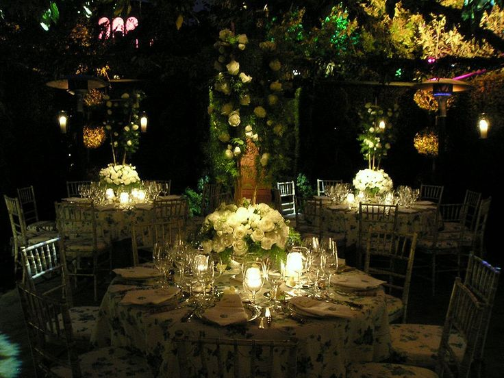 Night Garden Wedding. pretty. The table cloths are a little too much for me. And the seat covers.