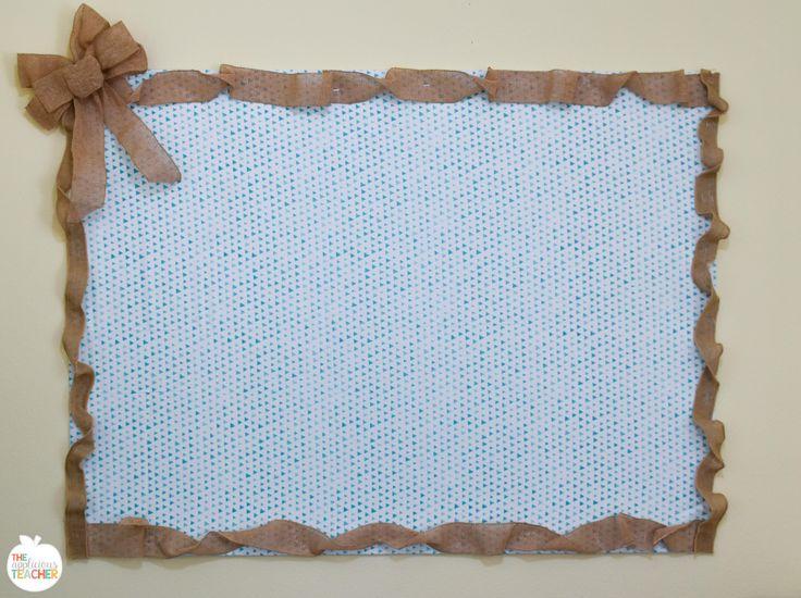 Homemade bulletin board using foam board and command strips.