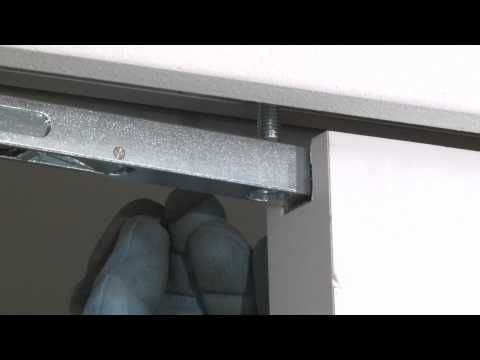 Installing the door on an Eclisse Syntesis Line pocket door system - YouTube