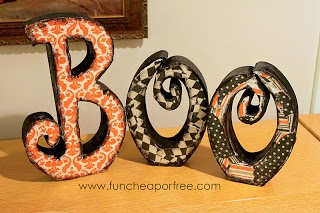 The Fun Cheap or Free Queen: Halloween craft.  Scrapbook paper on wooden letters.  Cute.