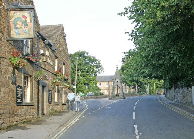 A view in old Dronfield village showing the Blue Stoops public house and the Peel Monument in the distance. The Corn Law monument was erected in 1846 to celebrate the repeal of the corn laws .