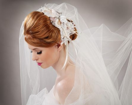 Bridal headpiece with details created from lace, beautiful draped beadwork with a delicate floral focal point.