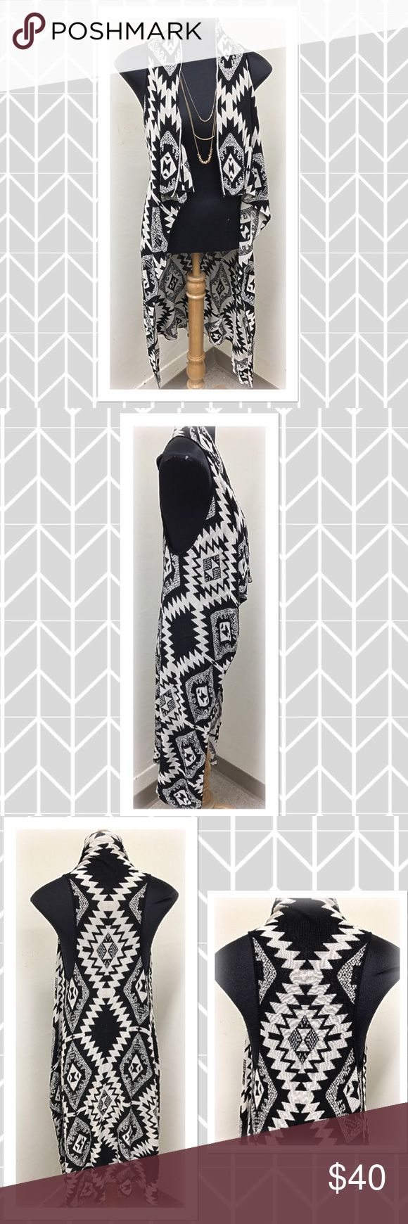 Black and white print long sleeveless vest Beautiful black and white tribal print long sleeveless vest with open draped front. This vest is so soft and comfy and just beautiful. Purchased here on Posh but never worn, brand new without tags. Material content is 100% rayon. Timing Jackets & Coats Vests