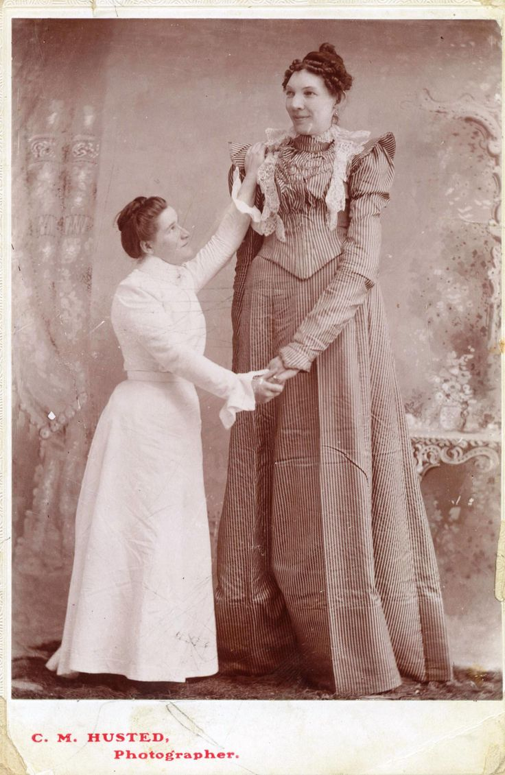 """ELLA KATE EWING (1872-1913): According to her publicity, Ella Kate Ewing, the Missouri Giantess, was 8 feet, 4 ½ inches tall, though her true height was closer to 7'3"""". She was born on March 9, 1872, in Louis County, Missouri, weighing seven and a half pounds at birth and grew normally until she was 9.  She died of pneumonia at the age of 40 and was extremely self-conscience of her size 24 feet until her death."""