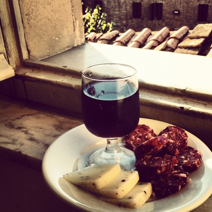 Truffled pecorino, wild boar sausage and a glass of Umbrian wine by the window in Perugia