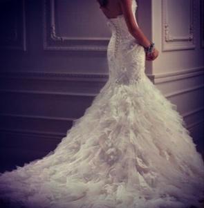 Feathered wedding dress . #beautiful