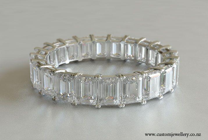 emerald cut wedding band on finger -