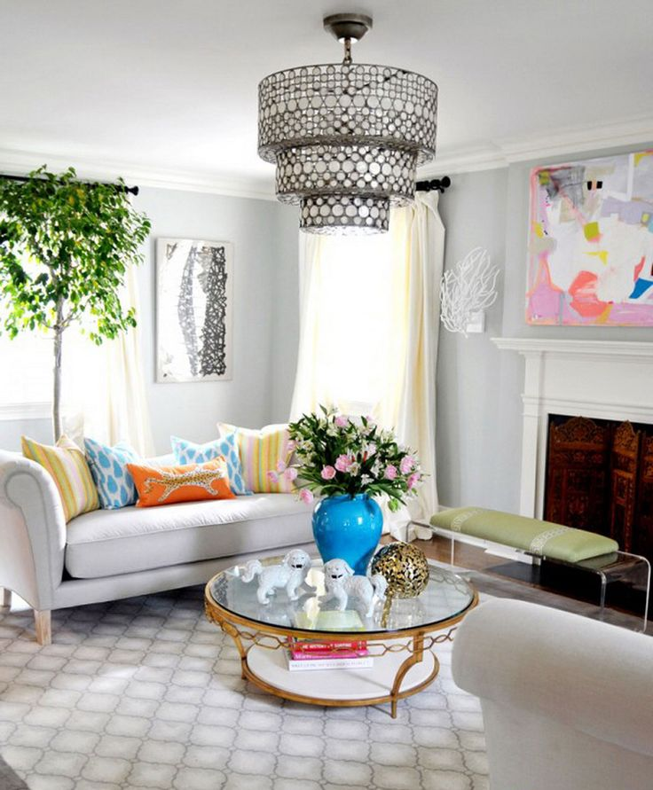 Amazing Pendant Light Above Round Glass Coffee Table Feat Cute Home Decorating Idea With White Bench Sofa And Colorful Cushions