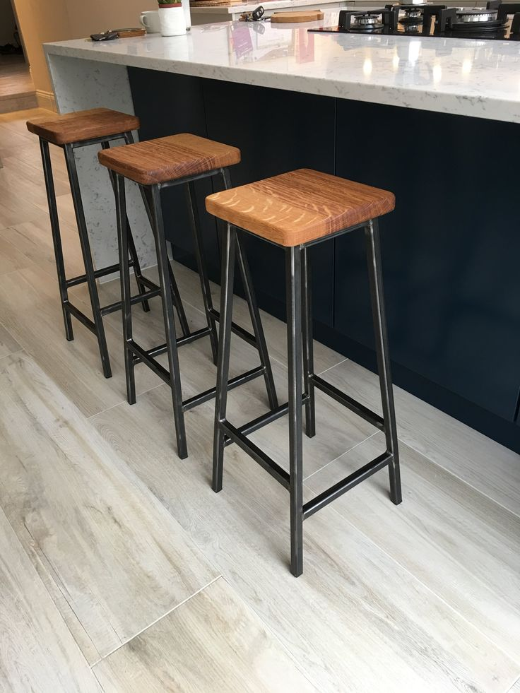 Simple design industrial bar stool (aka 'Bertie') made from 20mm steel square section. Welds are left 'proud'. The steel is protected with a coat of natural beeswax which will prevent rusting of the frame.Hard wearing plastic feet are inserted at base of legs to protect floors. Extremely robust and