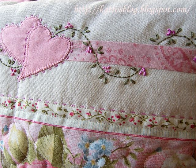 applique and embroidery on a quilt.