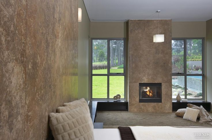 Contemporary fireplaces complement the modern look of this house without being overwhelming.