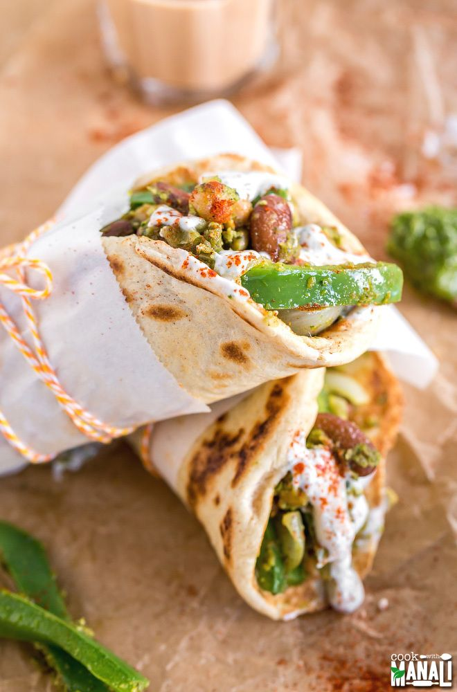Vegetarian Pita Wraps with chickpea, kidney beans and homemade pesto. Drizzled with yogurt dill sauce and smoked paprika on top, these make an easy dinner!