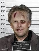 Arrested again Gary Busey mug shot.  Whoever clobbered him, I suspect he deserved it.