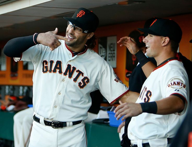 San Francisco Giants Michael Morse (38) points to Joe Panik (12) as he is introduced in the dug-out before the game against San Diego Padres at AT&T Park in San Francisco, Calif., on Monday, June 23, 2014. (Josie Lepe/Bay Area News Group)