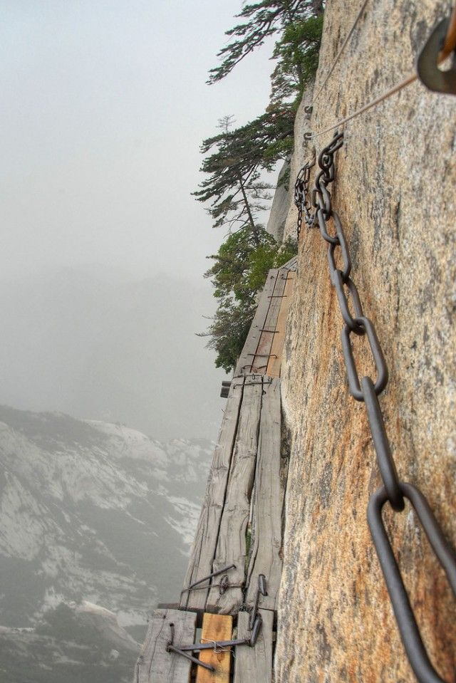 in China.. the Huashan plank path high up the Hua Shan mountain just outside the city Xi'an. Safety gear is obligated and advised but not checked. So you probably (understatement) should get it and check it twice!! Once on top.. the views are spectacular..