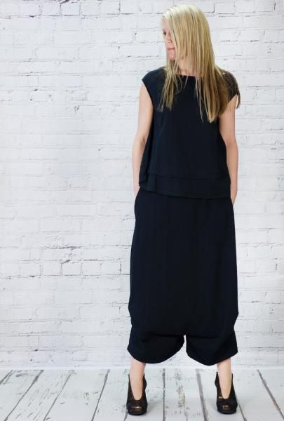 Mama b loose fitting sleeveless top. Really useful shape.100% cotton. worn with cotton jersey trousers, but this actually looks more like a skirt, as the inside leg is only a few inches. This is a great garment, feels fabulous on, and looks good too. Made in Italy