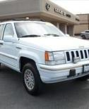 1995 Jeep Cherokee Grand. This is a great 4 wheel drive car with 195k miles, new tires and original high quality leather seats. It's currently mothballed and needs to be registered, but otherwise it could have another 100K miles in her. White with gold trim, fog lights and ski rack.