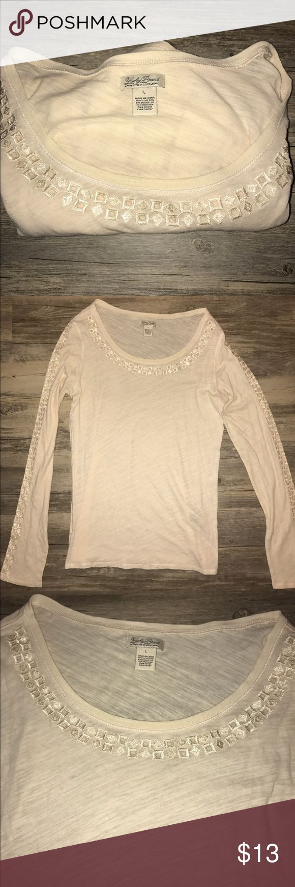NWOT/WOMEN'S LUCKY BRAND LONG SLEEVE EYELIT TSHIRT NWOT/WOMEN'S LUCKY BRAND CREAM LONG SLEEVE EYELIT TSHIRT! SZ: L! BRAND NEW‼️ AS IS‼️ NO TRADES‼️ Lucky Brand Tops Tees - Long Sleeve