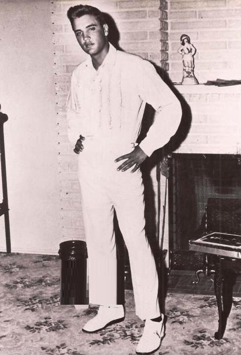 very rare: Elvis (portrait of Elvis hangs at bottom of staircase @ Graceland)
