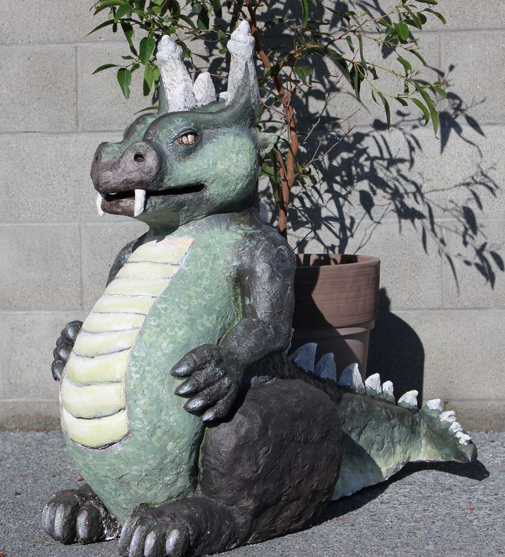 Dexter the green dragon.  Hand built using egg cartons, plastic bags, newspaper, polystyrene, masking tape and paper cement.  Finished with acrylic paint and sealer.